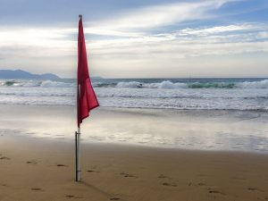 red flag on beach