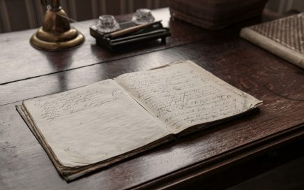 a journal open on a wooden desk