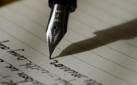 a fountain pen and writing