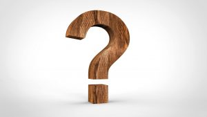 wooden question mark set against a white background