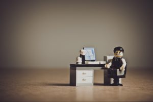 stressed out lego man sat at computer